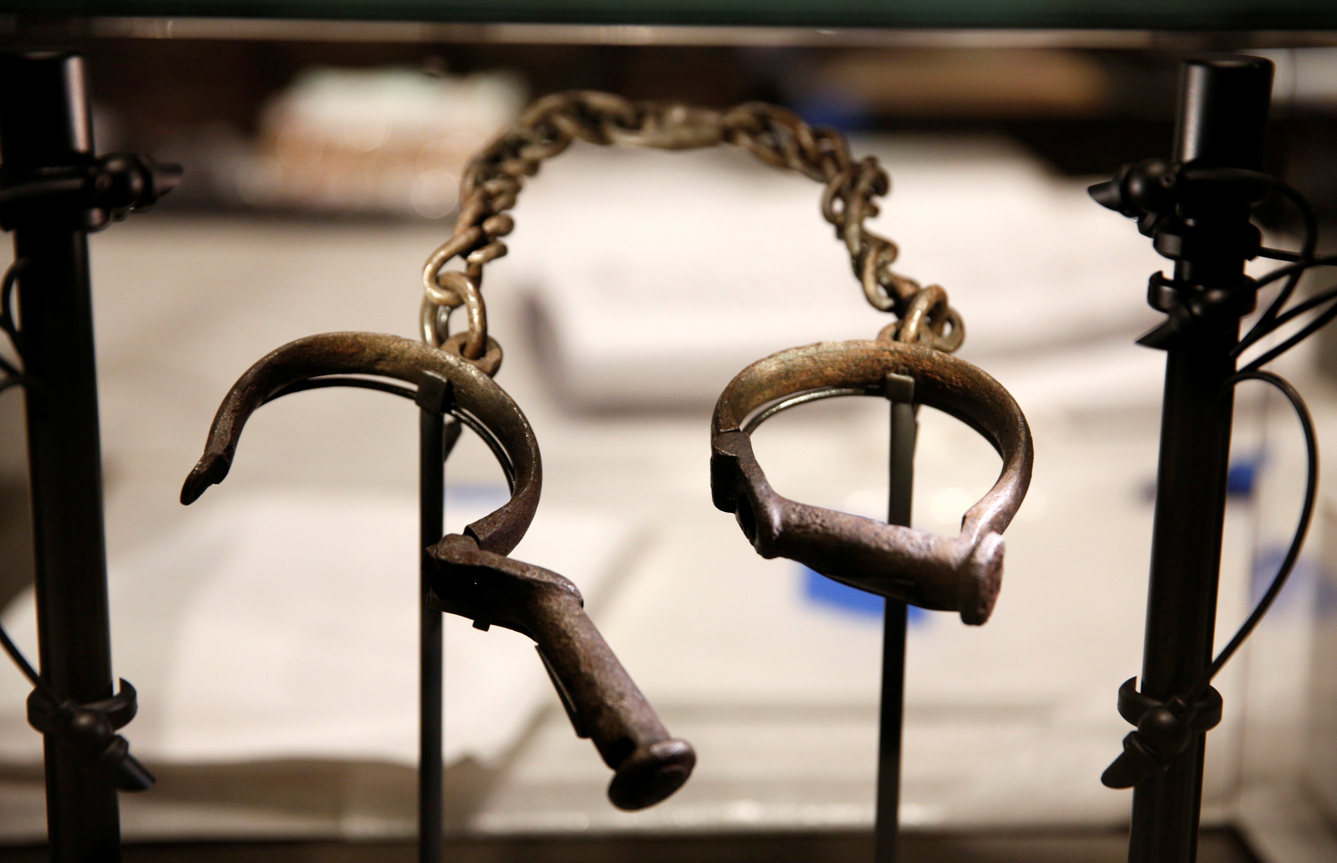 Slave shackles are seen in a display case during a media preview at the National Museum of African American History and Culture on the National Mall in Washington September 14, 2016. The museum will open to the public on September 24. REUTERS/Kevin Lamarque - D1BEUBHOEXAA