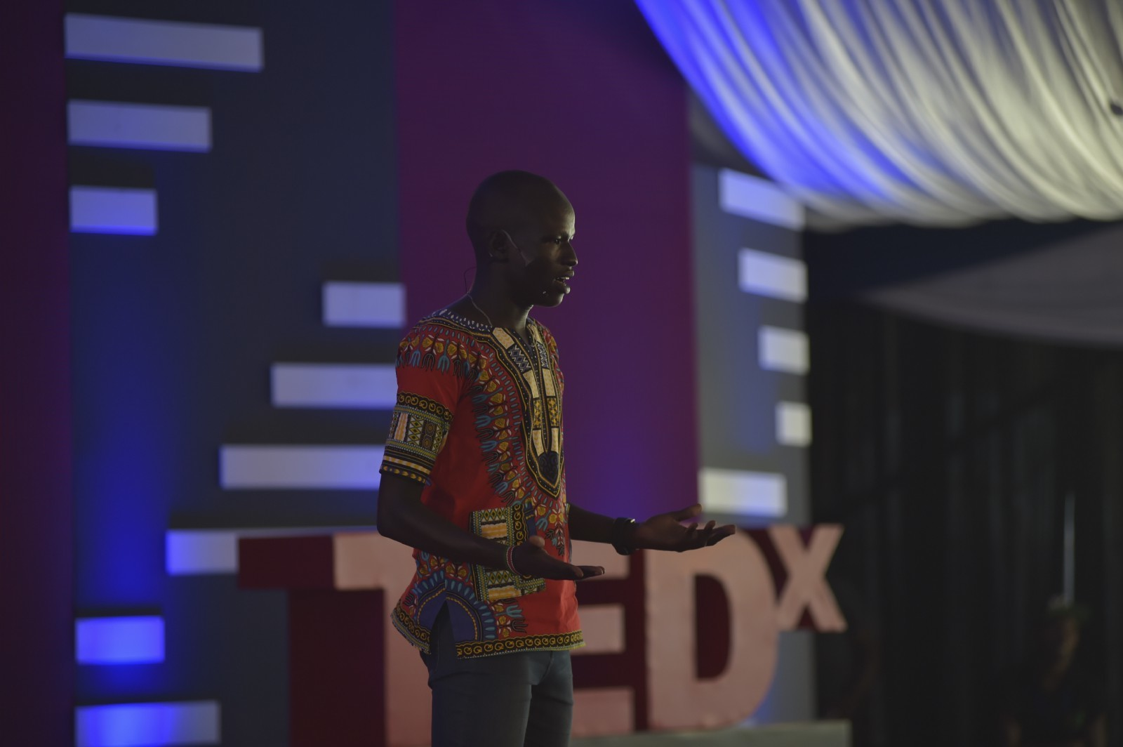 Pur Biel, who grew up in Kakuma refugee camp, on stage at TEDxKakumaCamp.