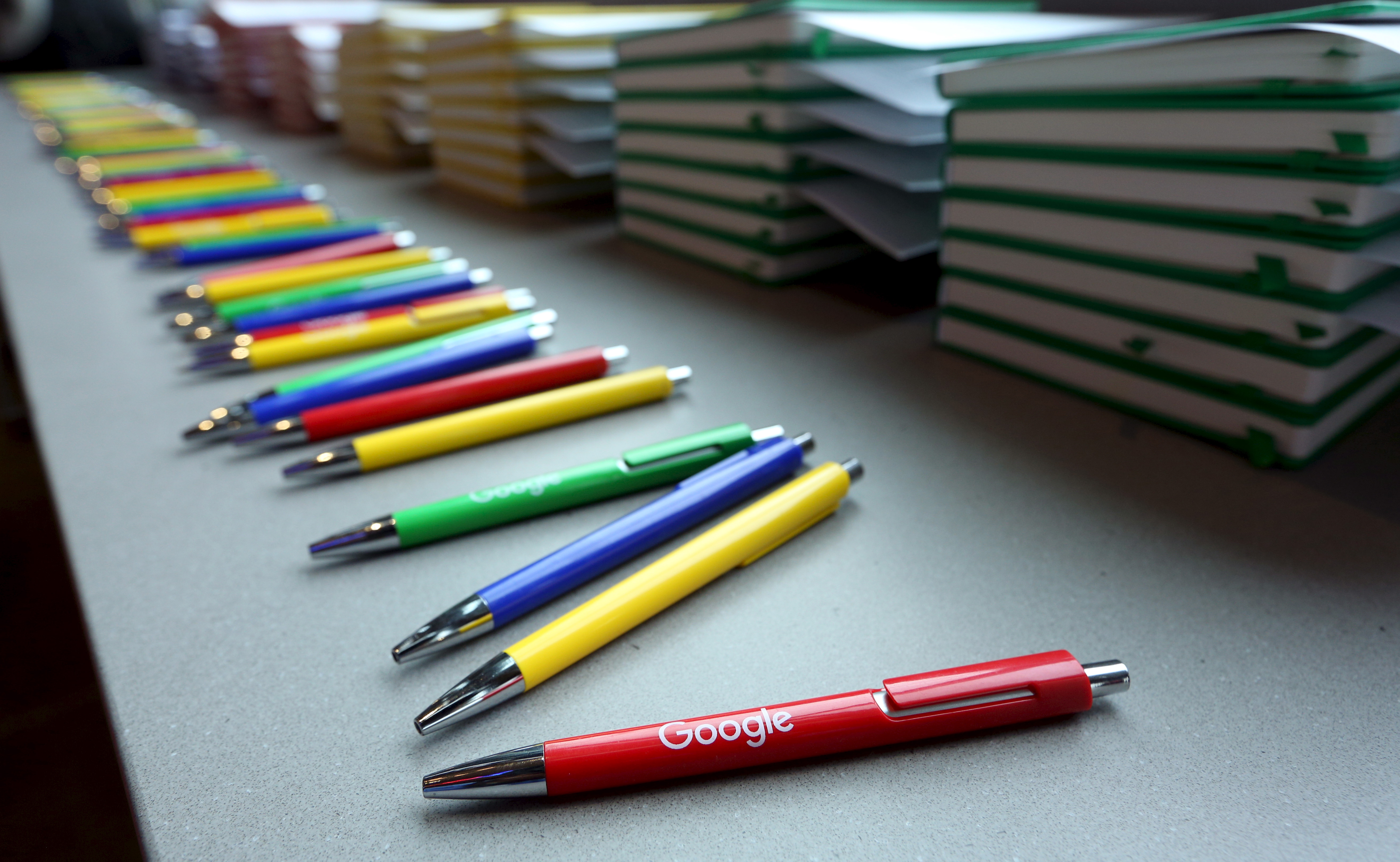 Pens and notebooks in Google's colors are prepared for the media before the unveiling of Google's new Canadian engineering headquarters in Kitchener-Waterloo, Ontario January 14, 2016. REUTERS/Peter Power - RTX22G09