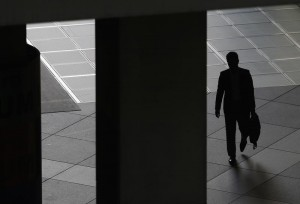 A man walks past a corridor at a commercial building in Tokyo's business district