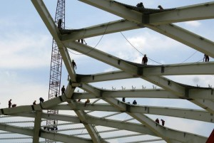 Steelworkers work on the roof structure inside the Arena Amazonia stadium as construction continues in preparation for the 2014 FIFA World Cup soccer championship in Manaus