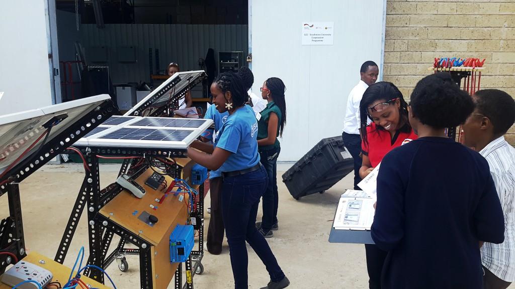 Hands-on excercise refering to manual, ASU-led VOCTEC program, all-women training Strathmore University, Nairobi April 2015. Photographer: Ambika Adhikari