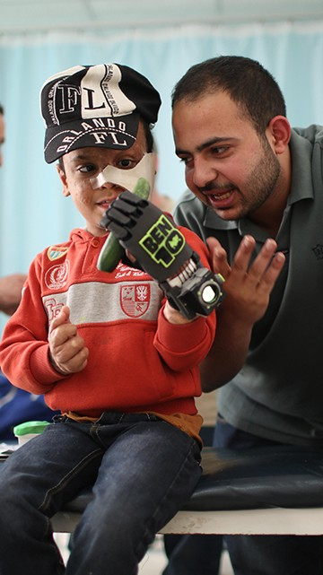 "Open-source 3D printed prosthetic hand, printed in carbon fiber-reinforced co-polyester, with an Arduino-powered Ben10 watch. Cost: $75. The hand was co-created with a 6-year-old Yemeni refugee treated by Doctors Without Borders. When asked who his superhero was, he said, ""Ben10."" A Jordanian mechanical designer based in Fab Lab Barcelona then customized this hand for him, including an embedded computer with animation of Ben10 aliens. Asem, working with our international expert in Amman, printed and fit the hand."