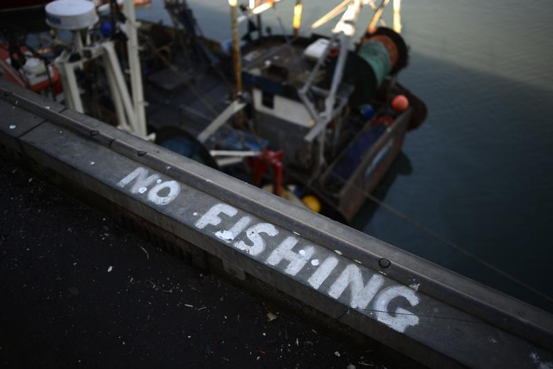 A 'No Fishing' sign is painted onto the quayside in Scarborough