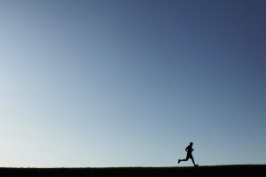 Jogger runs around Chestnut Hill Reservoir in Boston