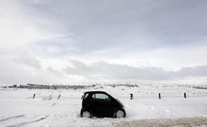 A vehicle trapped overnight by an ice storm sits abandoned on the Glenshane Pass in Northern Ireland